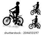 a boy rides a bike  | Shutterstock .eps vector #204653197