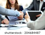 business people shaking hands ... | Shutterstock . vector #204684487