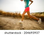 young woman on her evening jog...   Shutterstock . vector #204693937