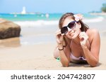 young woman in white bikini... | Shutterstock . vector #204742807