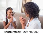 pretty mother playing clapping... | Shutterstock . vector #204783907