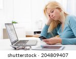 lazy blonde woman doesn't want... | Shutterstock . vector #204809407