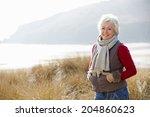 senior woman walking through... | Shutterstock . vector #204860623