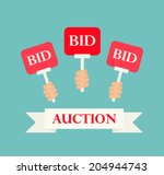 hands holding auction paddles ... | Shutterstock .eps vector #204944743