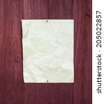 old paper on wooden wall  | Shutterstock . vector #205022857