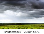 Dark Stormy Clouds Over A Gree...