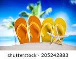 flip flops and sand  | Shutterstock . vector #205242883