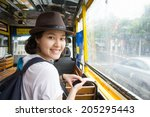 Young Asian Woman In The Bus...