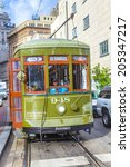 Small photo of NEW ORLEANS, USA - JULY 17, 2013: Streetcar Line St. Charles in new Orleans, USA. Newly revamped after Hurricane Katrina in 2005, the New Orleans Streetcar line began electric operation in 1893.