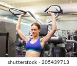 fit focused brunette using... | Shutterstock . vector #205439713