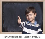 cute little boy posing in front ... | Shutterstock . vector #205459873