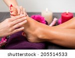 woman having a pedicure... | Shutterstock . vector #205514533