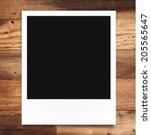 blank photo frame on brown wood ... | Shutterstock . vector #205565647