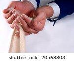 business hands holding sand | Shutterstock . vector #20568803