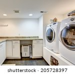laundry room with storage...