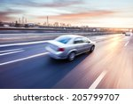 car driving on freeway at... | Shutterstock . vector #205799707