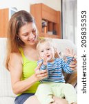 happy woman with toddler on... | Shutterstock . vector #205835353