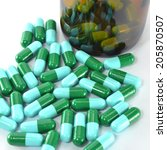 close up of bottle with pills