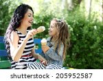 Happy Mom And Daughter. Walk I...