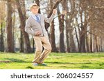 senior man playing air guitar... | Shutterstock . vector #206024557