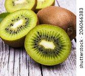 Fresh Kiwi Fruits On Wooden...