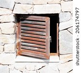 Small photo of stone wall background with a trap door