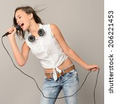 singing teenage girl with... | Shutterstock . vector #206221453