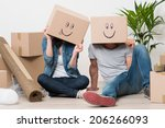 couple with cardboard boxes on...   Shutterstock . vector #206266093