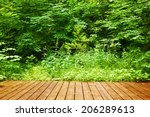 Wooden Floor In A Green Forest...
