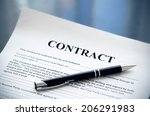 pen on the contract papers | Shutterstock . vector #206291983
