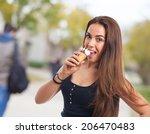 portrait of a girl holding a... | Shutterstock . vector #206470483