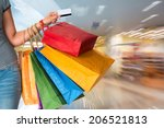 female holding shopping bags at ... | Shutterstock . vector #206521813