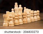 chess figures on wooden board | Shutterstock . vector #206833273
