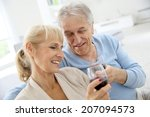 senior couple at home drinking... | Shutterstock . vector #207094573