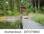 Small Forest Lake With Bridge...