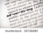 "Selective focus on the word ""advertising"". Many more word photos in my portfolio... - stock photo"