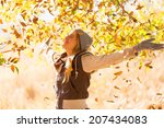 Autumn Leaves Falling On Happy...