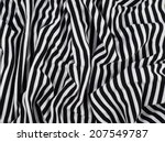 Stock photo fragment of a striped wrinkled black and white piece of a cloth fabric as a background texture 207549787