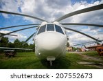 old helicopter on parking | Shutterstock . vector #207552673