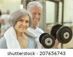 Senior Couple Exercising In A...