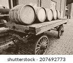 Small photo of Wooden barrels on an old-fashioned cart