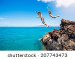 friends cliff jumping into the... | Shutterstock . vector #207743473