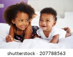 sister with baby brother lying... | Shutterstock . vector #207788563