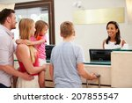family checking in at hotel... | Shutterstock . vector #207855547