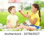 little girl and boy are blowing ... | Shutterstock . vector #207865027