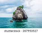 tropical rock island against...   Shutterstock . vector #207953527
