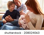family sitting on sofa with... | Shutterstock . vector #208024063
