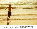 Boy Moves On The Surf Board ...