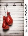 boxing gloves hanging on wooden ... | Shutterstock . vector #208042003