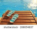 Flip Flops On Wooden Sunbed An...